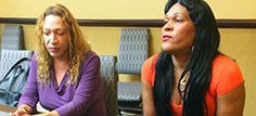 Estefania Hernandez, left, and Nairobi Castillo participate in a USAID-funded workshop on better health care for transgender people in Santo Domingo, Dominican Republic.