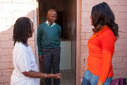 Two community workers talk to a student