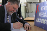 Photo of David Stanton signing a piece of paper