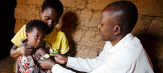 A young child gets a band aid after receiving a vaccine.