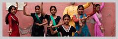 Women wearing saris strike a pose