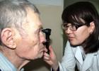 Dr. Cholpon Sadyrbaeva examines an elderly patient in Bishkek, Kyrgyzstan.