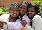 Carole Nyamoita, center, has known friends Elizabeth Njeri, left, and Cathy Magio since high school.