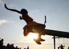 A young girl tests out a new seesaw on a playground built by the Elizabeth Glaser Pediatric AIDS Foundation at the Mkhulamini Cl