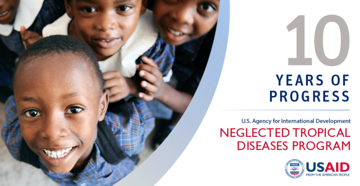 Cover of the 10 Years of Progress Report: USAID Neglected Tropical Diseases Program showing students looking up at the camera.