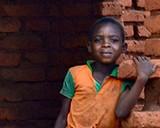 A boy eats lunch at a Morogoro village in Tanzania. © 2013 Jennifer Applegate, Courtesy of Photoshare
