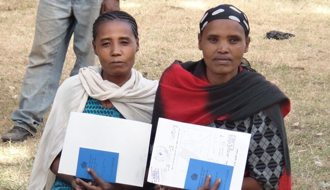 These two women in the village of Abeye, Ethiopia, obtained land certificates through a USAID program. After establishing rights