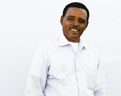Abebaw Gessese, the owner of a poultry farm in Mojo, Ethiopia, received a $132,000 loan from Dashen Bank thanks to a USAID guara