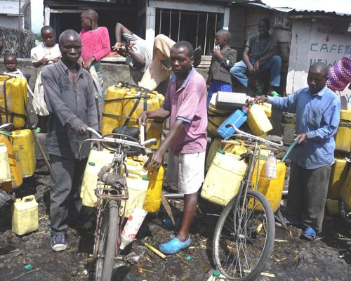 Mobile water sellers fill their cans in Goma, where the Nyiragongo volcano destroyed 40 percent of the Congolese water utility n