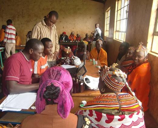 Teaching Kenyan pastoralists about livestock insurance.