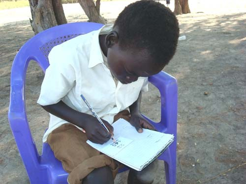 A primary school student in Juba takes his second grade evaluation test.