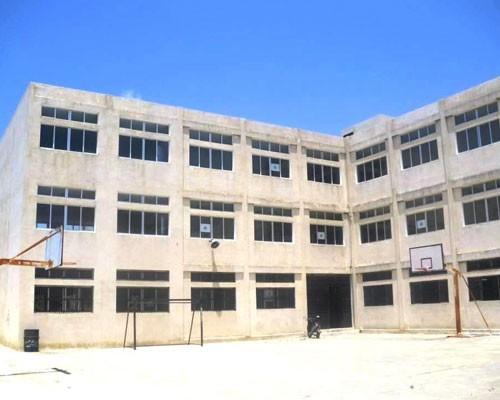 Tayr Felsay Intermediate School before waterproofing of the external façade of the building.