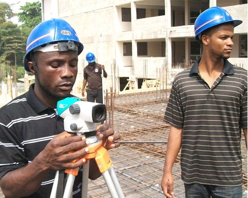 Sylvester Bundoo, left, and Mahmoud Solomon put the survey skills they are learning in the classroom to use during survey practi