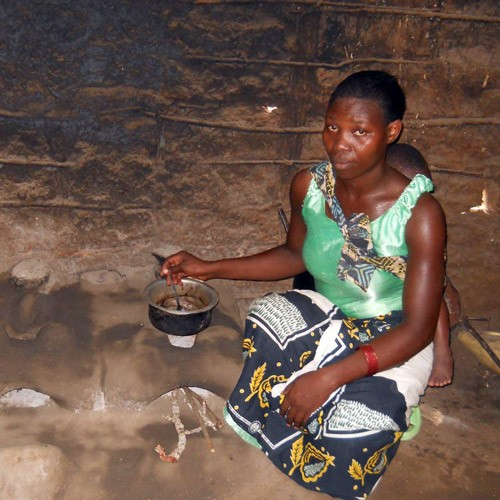 Rukia Seif cooks on one of her fuel efficient stoves.