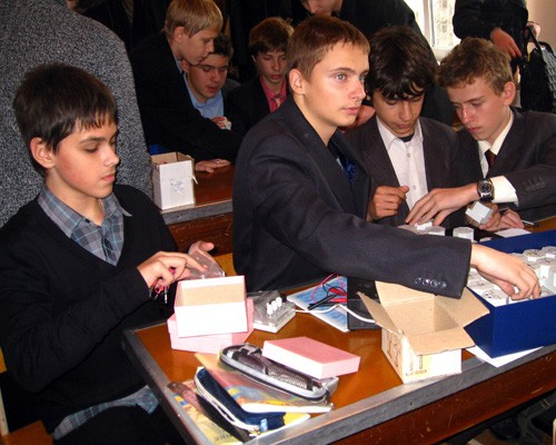 School boys from Ukraine's Lyceum No.25 in Zhytomyr use new lab equipment in their physics course.