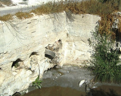 Below, just two months after USAID began working with stone companies to properly dispose of the slurry, this waterway was no lo