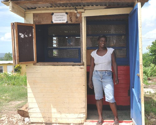 After closing her shop and fleeing her community of Gravel Heights, Paulette Simpson was happy to return home and reopen her gro
