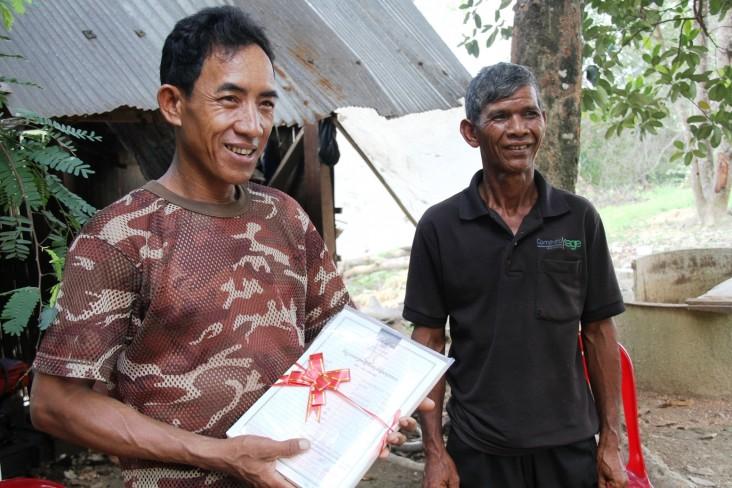 Kverk Sarak, left, the O'Rona community team leader, and Hung Chak, deputy team leader.