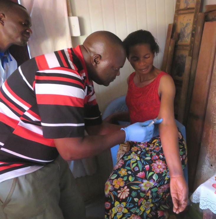 A nurse preps Veronique Kabadi for a contraceptive implant.