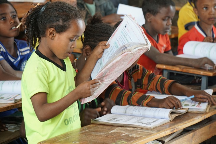 A student at the Soke Bukicha Primary School in Arsi Zone, Oromia Region, practices reading on a Oromiffa Textbook produced by U