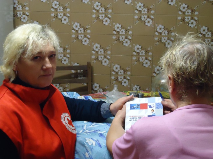 A nurse visits TB patient's home as part of a project to provide outpatient, home-based care for TB.