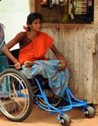 USAID works with its global partners to provide proper, well-fitted wheelchairs to persons with disabilities like Lalithamma, in