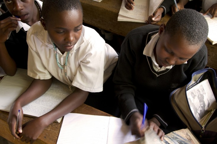 Ugandan girls reading during the UNITY program