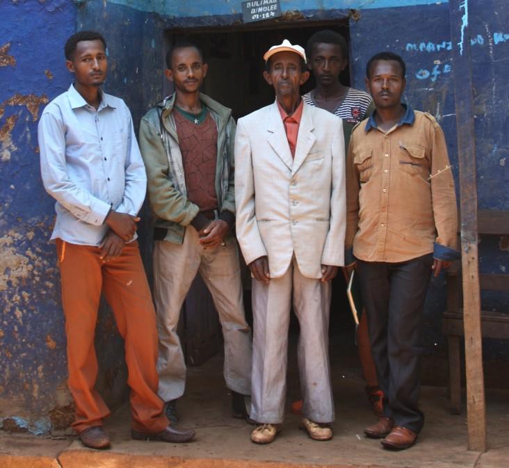 Farmer Debela Ofosea, center, poses with his four sons.
