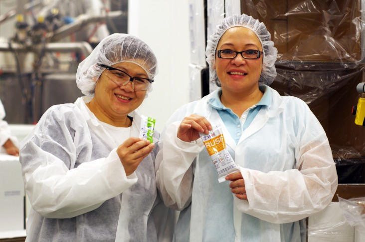 Edesia employees display nutritional products that will be used to treat malnutrition.