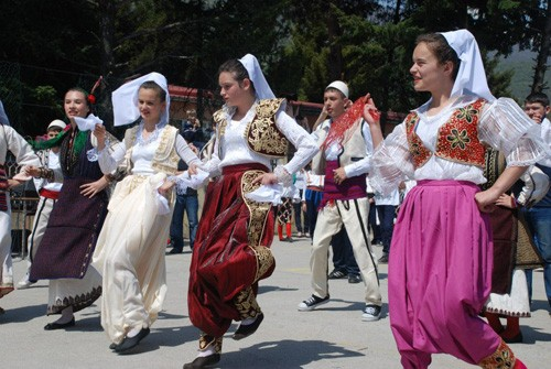 Macedonian students wearing traditional dress dance April on 24, 2013, at a ceremony celebrating EUCOM/USAID-backed school refur