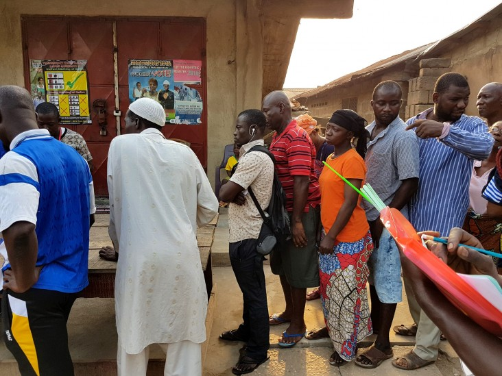 Ghanaians line up to cast their votes on Election Day.