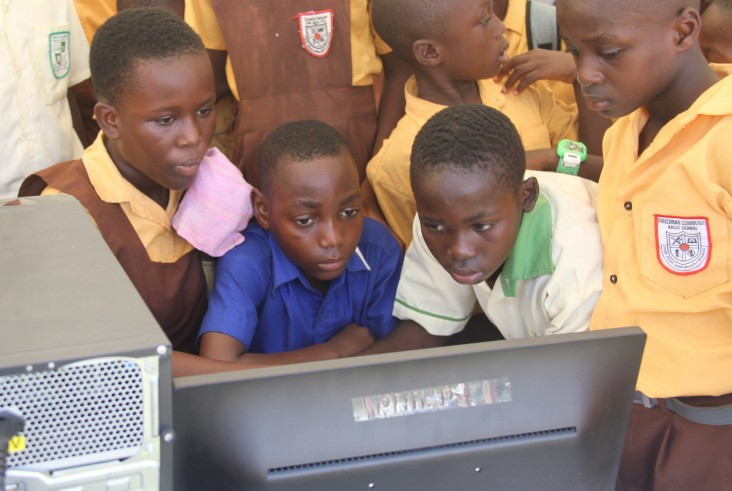 Children are captivated by computer reading applications at the reading festival in Accra.