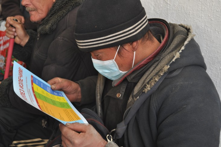 A person at risk reads a brochure about TB during a mass TB testing event in Bishkek, Kyrgyzstan, as part of World TB Day.