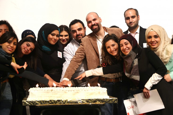 Nahnoo staff and volunteers celebrate the fifth anniversary of the organization with its founder, Mohamad Ayoub, center.