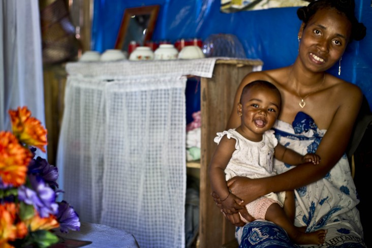 A woman and her baby after receiving counsel from a community health worker in their home in Boforene, Madagascar