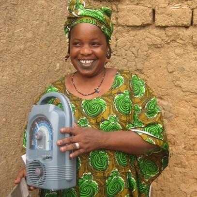 Malian woman with solar-powered radio