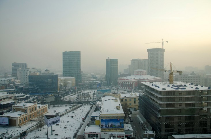 The blue skyline of Ulaanbaatar is littered with unfinished buildings and infamous winter air pollution.