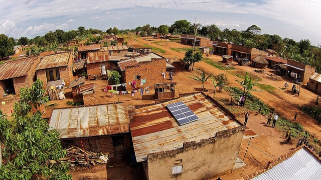 This 500W solar system in a rural village in Uganda powers a home, drives a public broadcasting system, a barbershop and a video