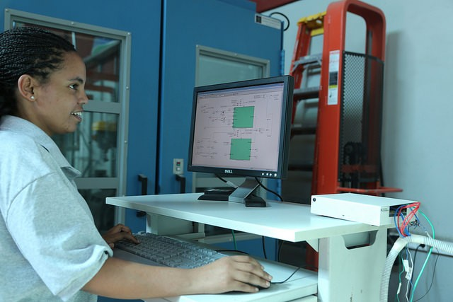 A dVentus Engineer in the office conducting tests