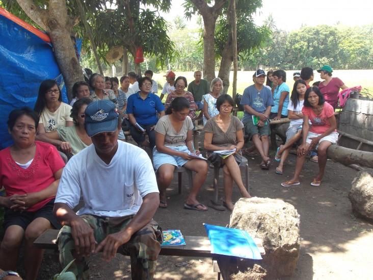 Farmers attend a Climate Field School session in barangay San Antonio Ogbon in Nabua, Camarines Sur.
