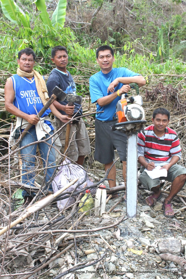 PNNI staff with another confiscated unregistered chainsaw used for illegal logging in southern Palawan.
