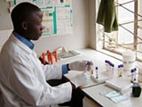 A lab technician working on test tubes