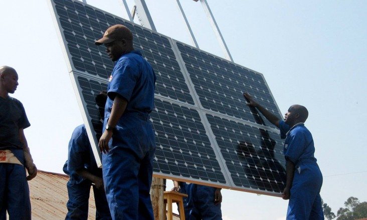 Training workers to properly install solar panels at health clinics in Rwanda provides clean energy and creates green jobs.