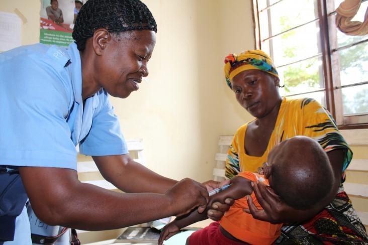 A health provider in Tabora, Tanzania gives a child an immunization shot.