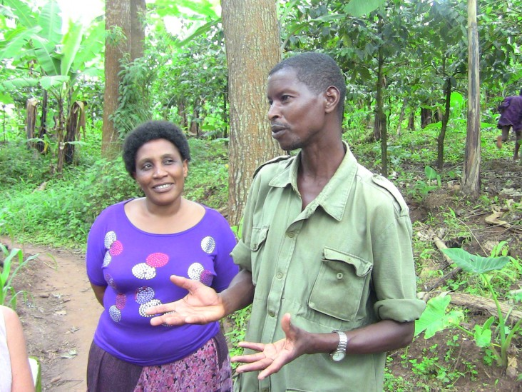 After receiving training from the USAID program, Bonaventura Luzilo, right, from the Tanzanian village of Kalinzi, started a tre
