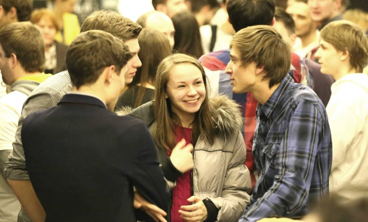 One of the teams chats with people who arrive to hear the final pitches at the hackathon in Ukraine.