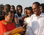 The head of a female sex worker cooperative conducts a street session in Ethiopia on how to use a condom properly.