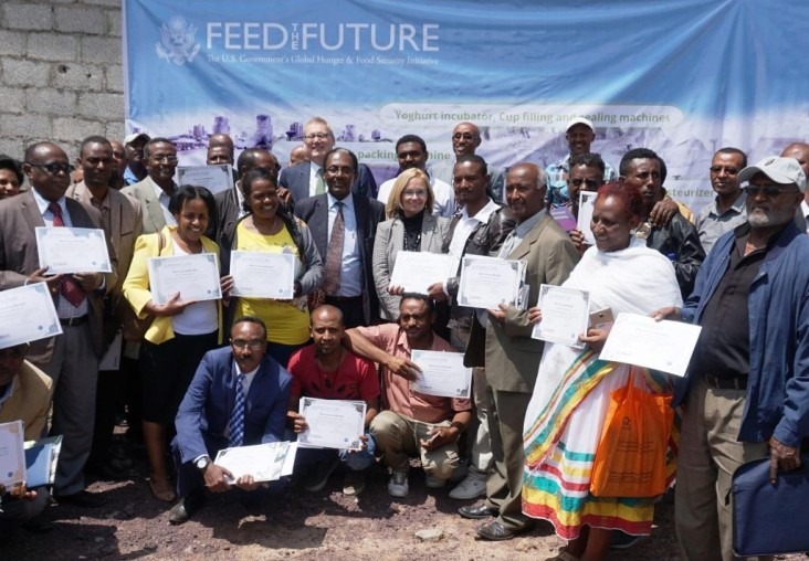 USAID Mission Director Leslie Reed and Minister of Livestock and Fisheries Fekadu Beyene with USAID grantees and CNFA's Marc Steen