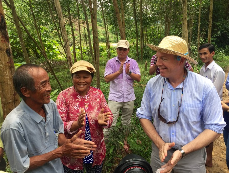 U.S. Ambassador Ted Osius talks to local people about their livelihoods after the launch.