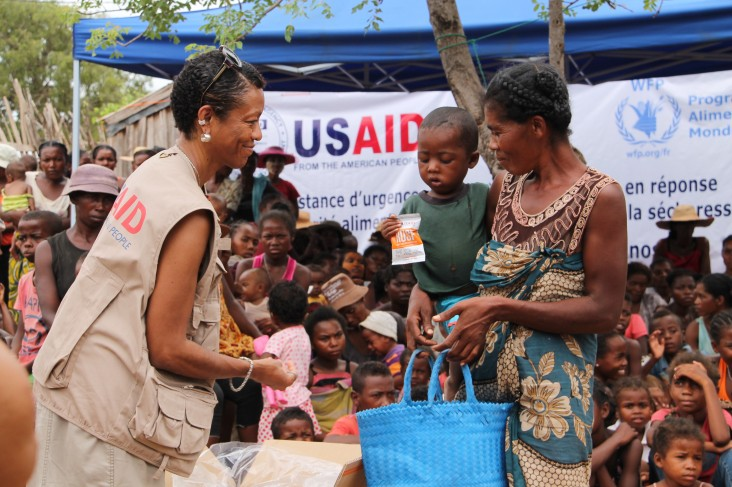 Mission Director Michelle Godette distributes supplemental food for children with moderate acute malnutrition